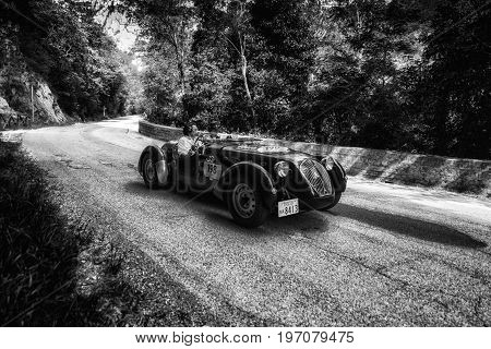 GOLA DEL FURLO, ITALY - MAY 19: HEALEY 2400 SILVERSTONE D-TYPE 1949 on an old racing car in rally Mille Miglia 2017 the famous italian historical race (1927-1957) on May 19 2017