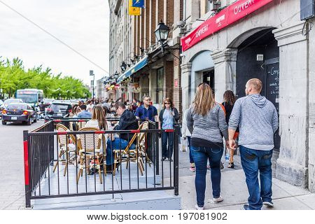 Montreal, Canada - May 27, 2017: Old Town Area With Couple Walking By Restaurant In City In Quebec R