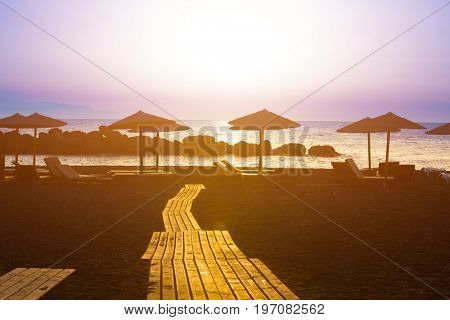 Wooden pavement on the beach at sunset time