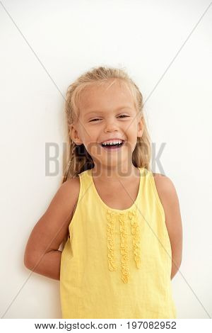 Portrait of laughing little girl, isolated on white