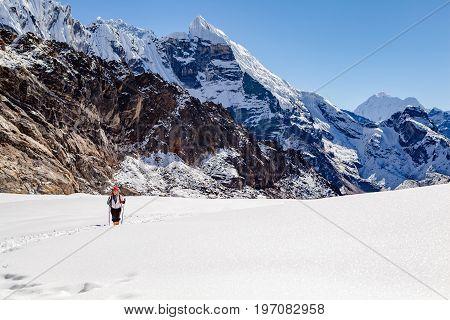 Hiking Woman Crossing Cho La Pass. Himalaya Beautiful Mountain Peaks Inspirational Autumn Himalayas Landscape in Everest National Park Nepal.