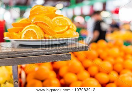 Macro Closeup Of Slices Orange Samples In Farmers Market