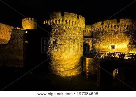 Kalemegdan fortress wooden bridge, gates and towers at night in Belgrade, Serbia