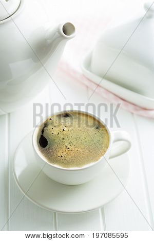 The coffee cup on white table.