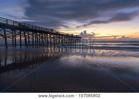 Sunrise over the Atlantic Ocean at the pier in Flagler Beach Florida.