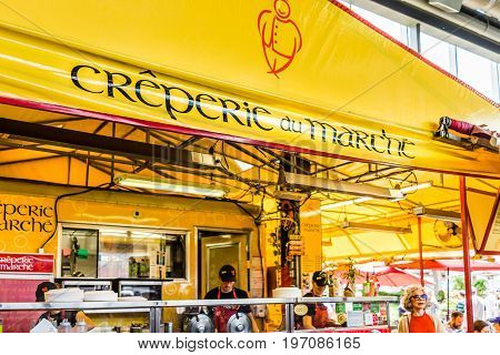 Montreal, Canada - May 28, 2017: Jean Talon Market Creperie Yellow Restaurant Sign Inside Building C