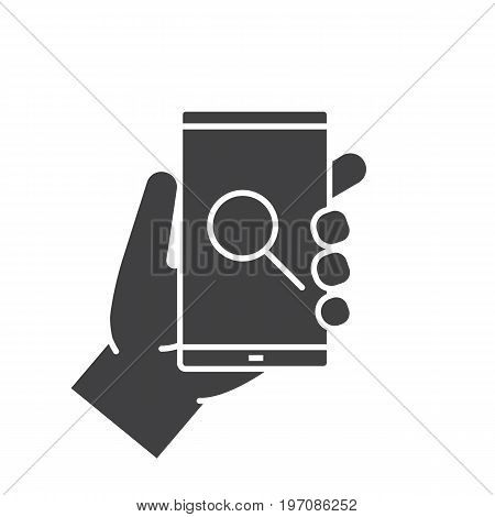 Hand holding smartphone glyph icon. Silhouette symbol. Smartphone search app. Negative space. Vector isolated illustration