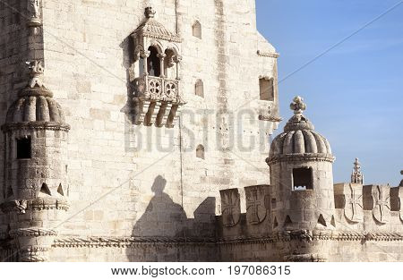 LISBON, PORTUGAL-MARCH 11 2016: A lot of tourists visite the Belem tower in the other at the entrance of the city of Lisbon in a side of Tagus river on March 11, 2016