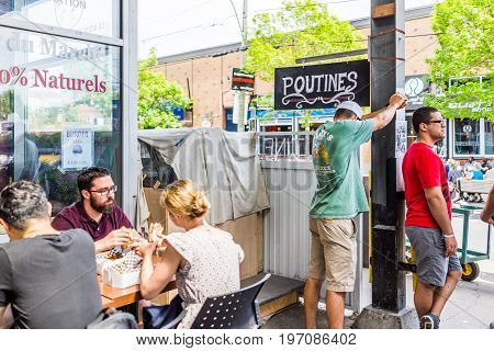 Montreal, Canada - May 28, 2017: Jean Talon Market Poutine Restaurant Sign Inside Building With Peop
