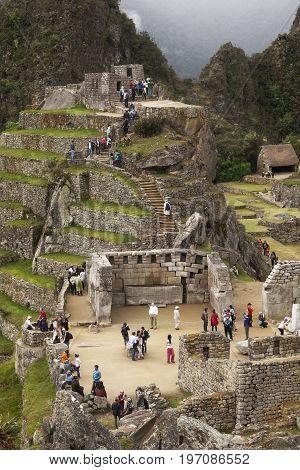MACHUPICCHU, PERU: JUNE 4 2015: Spiritual morning mist rises over Inca head mountain at Machu Picchu with Huana Picchu in background on June 14, 2015