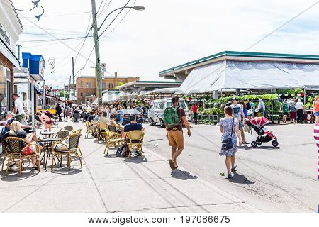 Montreal, Canada - May 28, 2017: People Walking By Produce Vegetable Stands Outside During Bright Su