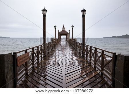 Frutillar bridge in front of Osorno Lake