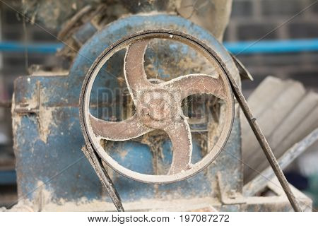 Old rusty pulley belt in old factory.Ditry machine.Unclean machine.