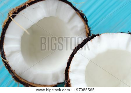 Juicy coconut in two halves with pulp