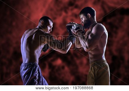 Experienced Coach Prepares A Young Fighter