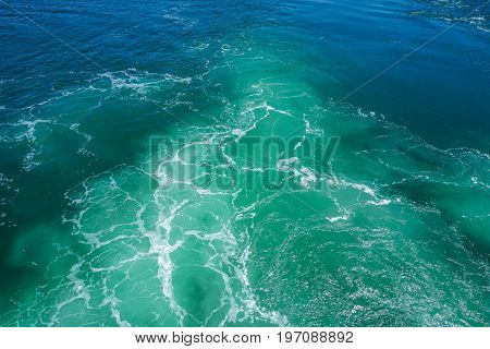 Blue, Green, and White Spume Turned Up By Ferry Propellers
