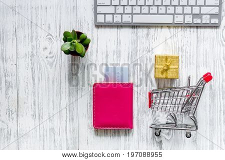 Shopping in webstore. Shopping cart, bank card and keyboard