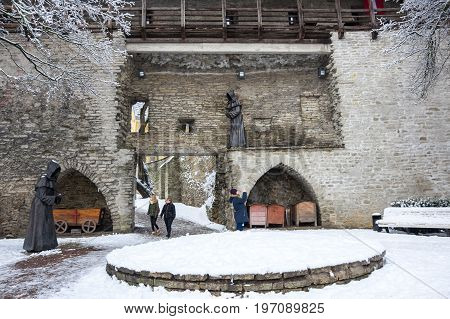 TALLINN ESTONIA - FEBRUARY 23 2016: Fortress wall of Old Town in Tallinn Estonia. Old Town is listed in the UNESCO World Heritage List