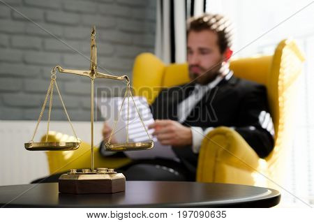 Weight scale of justice lawyer in background. lawyer document agreement attorney scales authority background balance concept
