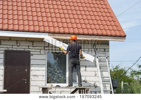 Builder Works On The Roof