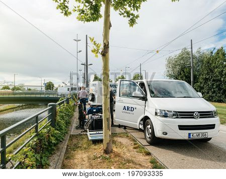 STRASBOURG FRANCE - JUN 30 2017: Volkswagen TV Media Television Trucks with multiple Satellite parabolic antennas and fiber optic cables preparing to report live the official European Ceremony. Ard is a Consortium of public broadcasters in Germany