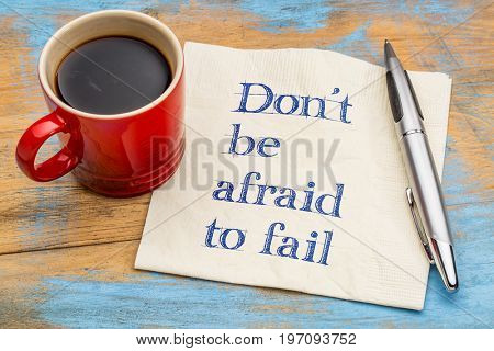 Do not be afraid to fail reminder or advice - handwriting on a napkin with a cup of coffee