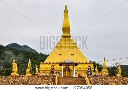 Golden stupa in the village Luang Nam Tha Northern Laos