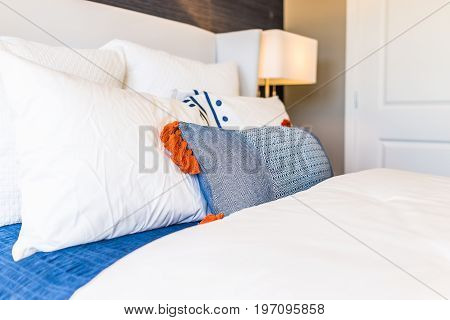 Closeup Of New Bed Comforter With Decorative Pillows In Bedroom