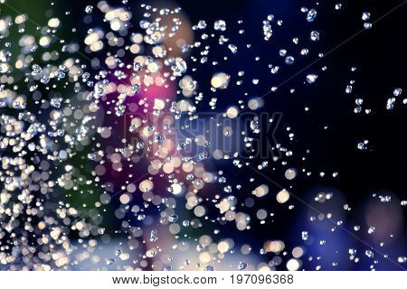 the blurred drops of water spray fountain