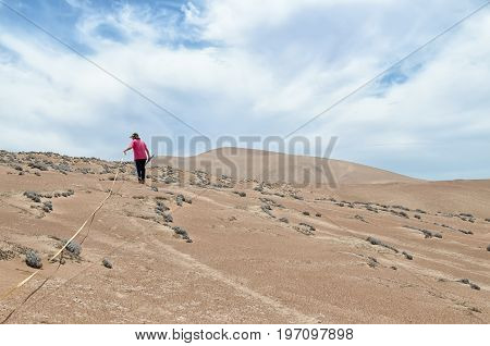 PATACHE CHILE 12 JANUARY 2017: Student doing recearch outdoors in desert