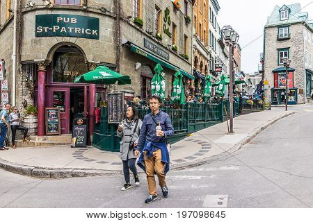 Quebec City, Canada - May 29, 2017: Old Town Street With People Walking By Pub St Patrick Restaurant