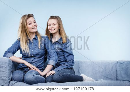 Two Happy Women Friends Wearing Jeans Outfit