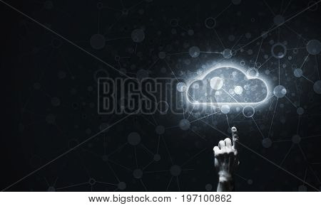 Mans hand pointing to light cloud on dark background