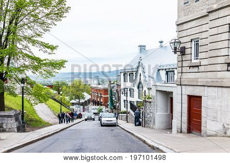 Quebec City, Canada - May 29, 2017: Old Town Steep Street On Incline With People Walking Up By Park