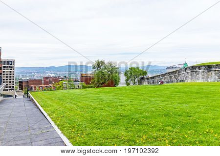 Quebec City, Canada - May 29, 2017: Green Grass Fields Plains In Park With Fortifications Stone Wall