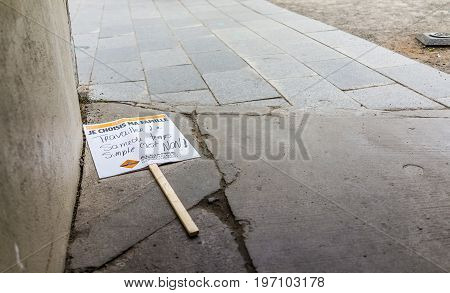 Quebec City, Canada - May 29, 2017: Protest Sign On Floor Of Cobblestone Street Saying