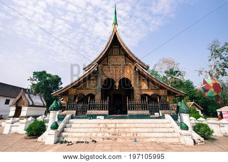 LUANG PRABANG LAOS - MARCH 11 2017: Front side picture of the Wat Xieng Thong Buddhist temple located in the city Luang Prabang capital of Laos.
