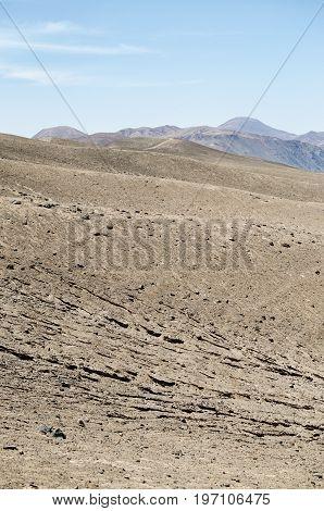 View to cracked arid land in desert