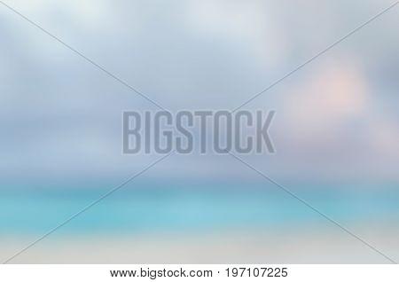 Defocused seascape under sunset sky - natural background