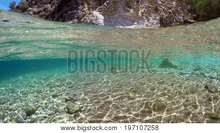 Half underwater close up, background split by waterline, Mediterranean Sea