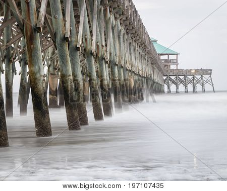 Ghostly waters at Folly Beach pier in South Carolina