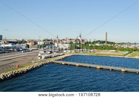 Tallin, Estonia-July 07, 2017: View of the Harbor at Tallin, Estonia as a cruise ship is arriving in the harbor