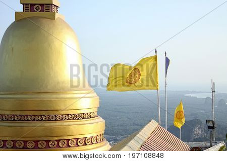 Temple golden dome Thai Buddhist flag and aerial view to the coast