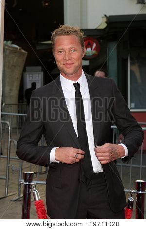 LOS ANGELES - AUG 23:  Martyn Lenoble arrives at the