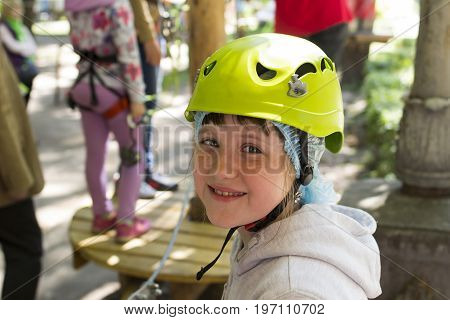 portrait girl child in mountaineering equipment during training