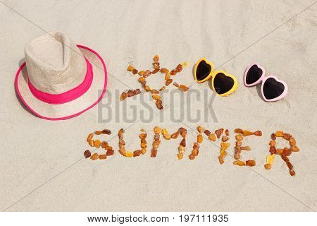 Shape Of Sun With Word Summer And Accessories For Vacation On Sand At Beach