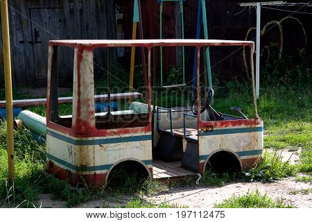 Picture of a children's game bus on an old children's playground