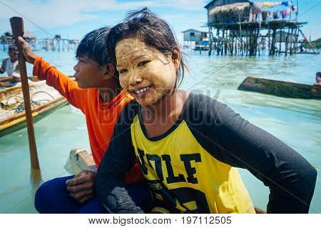 Semporna,Sabah,Malaysia-April 23,2017:Bajau Laut young lady with homemade cosmetic in Bodgaya Island,Semporna,Sabah,Malaysia.Its a mixture of rice powder that they apply on their faces as a sunscreen