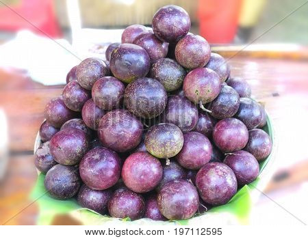 Ripe purple star apple fruit is stacked for sale to consumers