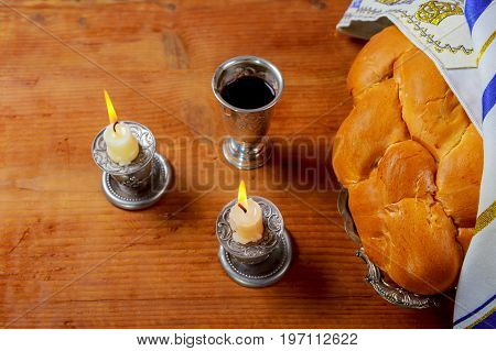 Sabbath Silver Kiddush Cup, Crystal Candlesticks With Lit Candles, And Challah Challahs